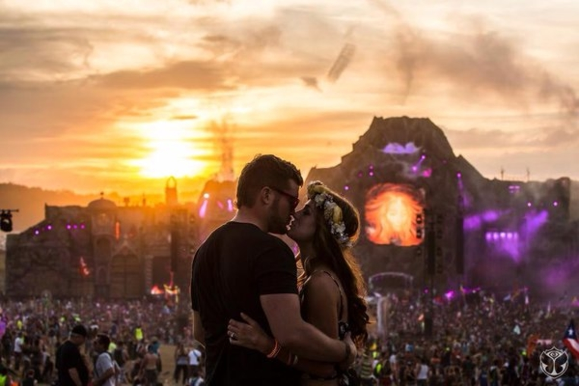 two people kissing at a festival