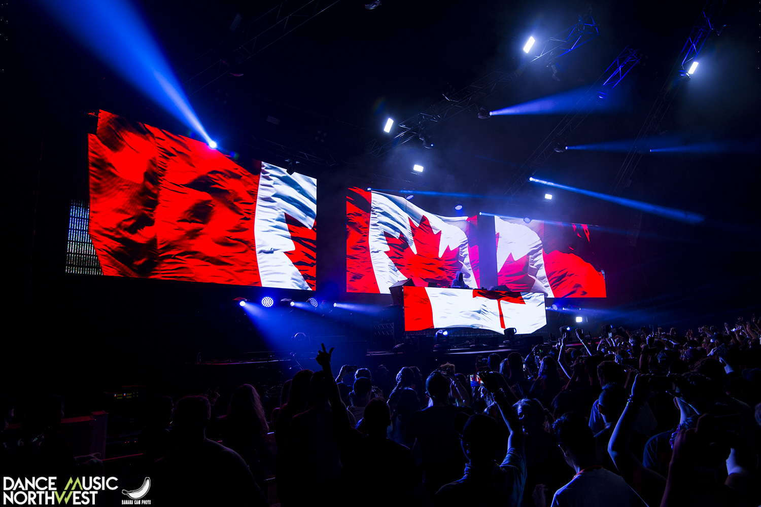 a canadian flag lit up on stagw